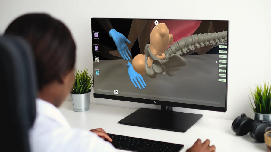 Picture of a woman looking at a 3D animation of shoulder dystocia