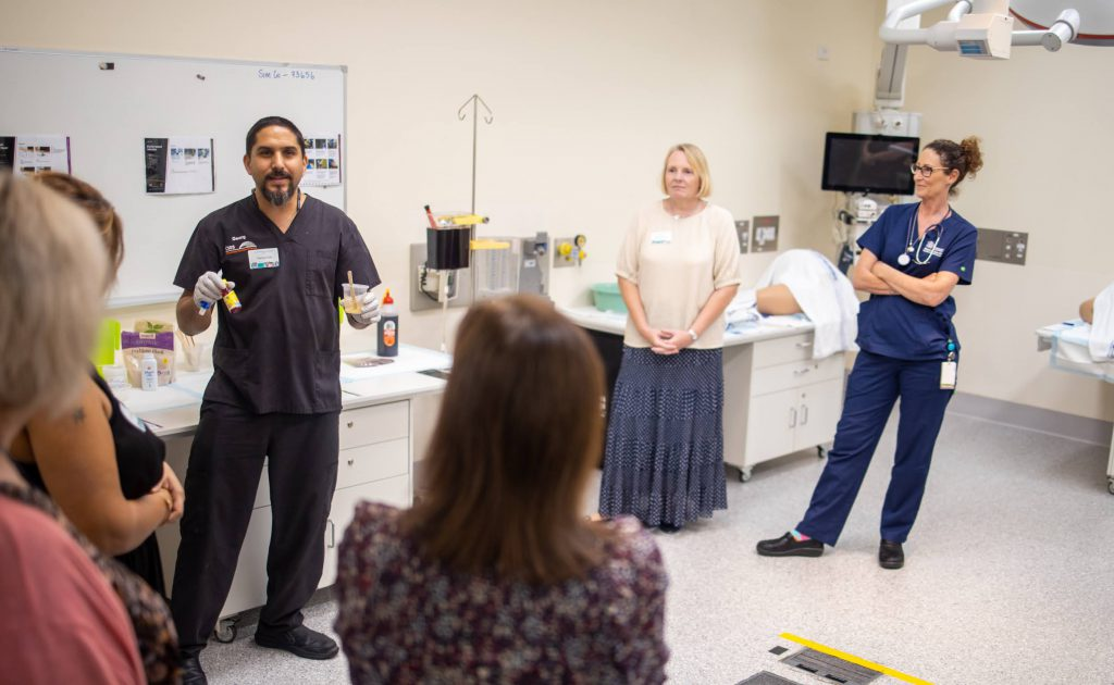 Georg Auer (in black scrubs, left) demonstrates how we create different kinds of moulage for clinical scenarios.